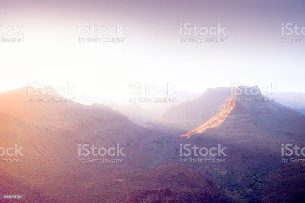 Violet mountains sunrise stock photo