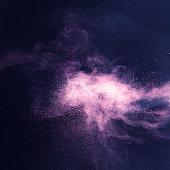 Violet powder exploding, studio shot, high sped technique, selective focus.