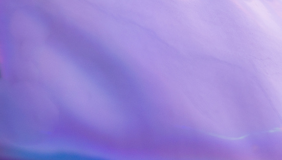 1057729052 istock photo Violet Purple and  Blue Defocused Blurred Motion Gradient Abstract Background 1198455427