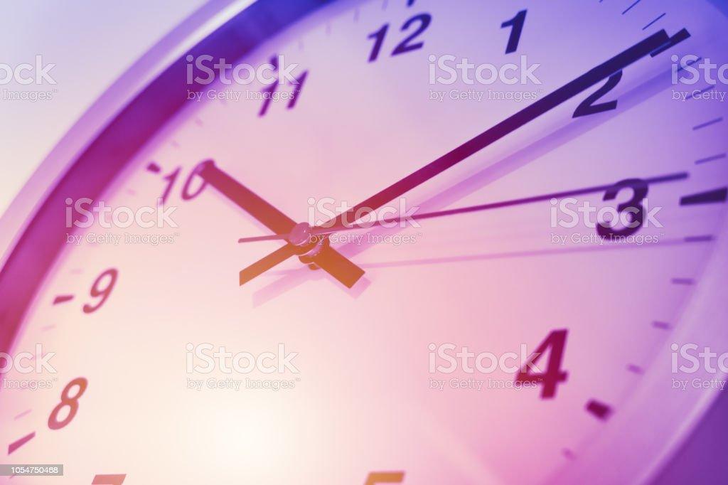violet purple times clock face closeup