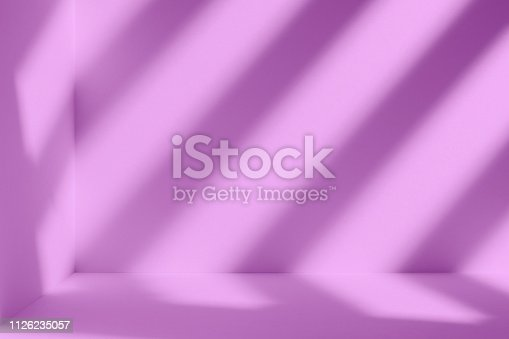 1062261710istockphoto Violet room with artistic shadow 1126235057