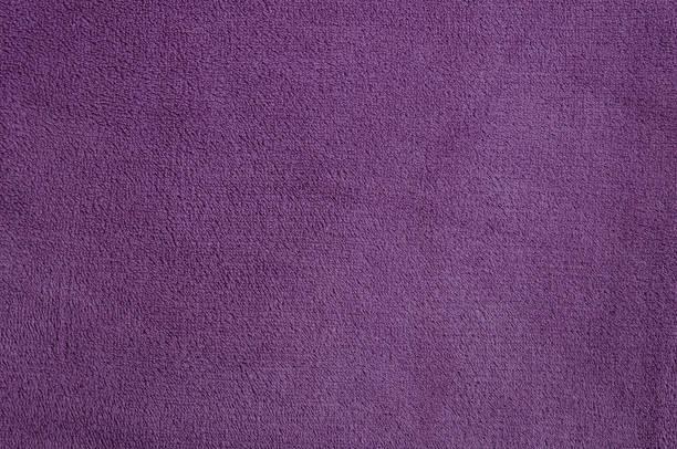 violet texture of nap textile - teppichmaterial stock-fotos und bilder