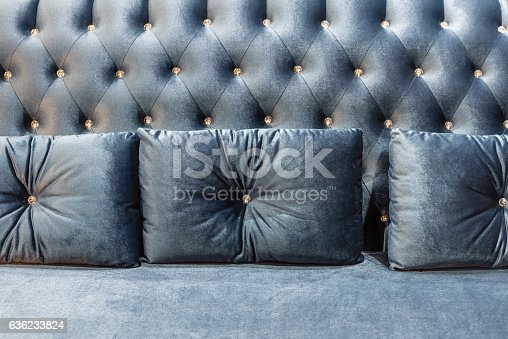 Close up of violet velvet sofa and cushions with vintage style