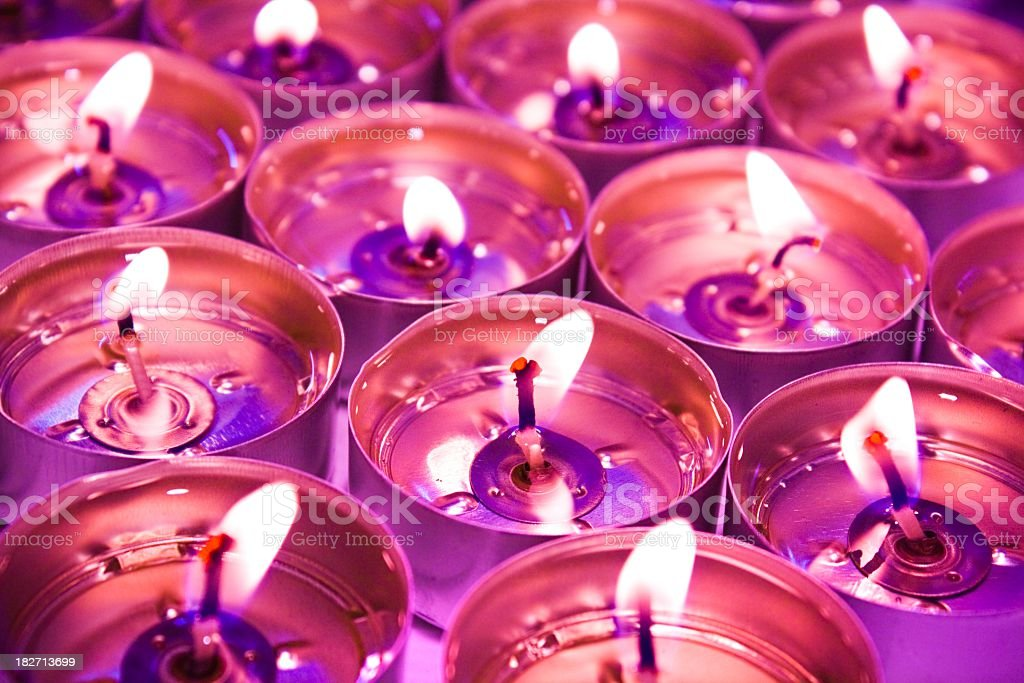 violette burning candlelights background royalty-free stock photo