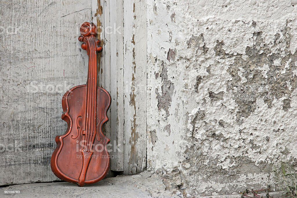 violin against the door royalty-free stock photo