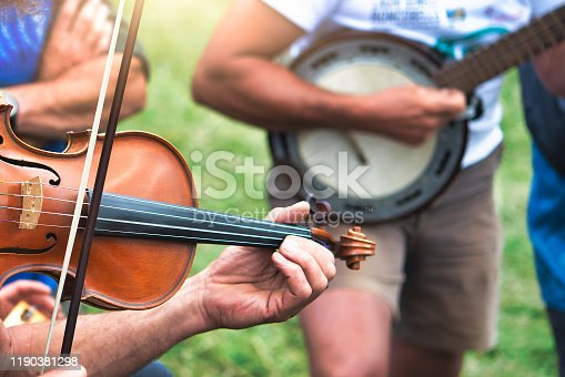 Violin and banjo played outdoors in a popular country party,jpg