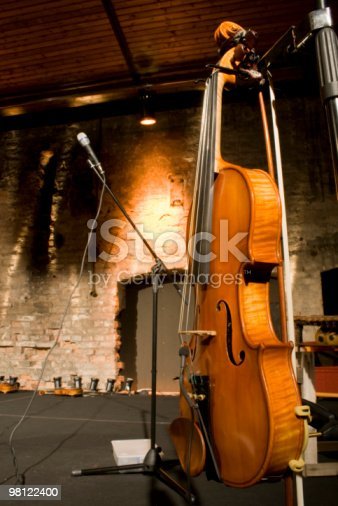 Violin And Bow Displayed On Stage Stock Photo & More Pictures of Bow - Musical Equipment