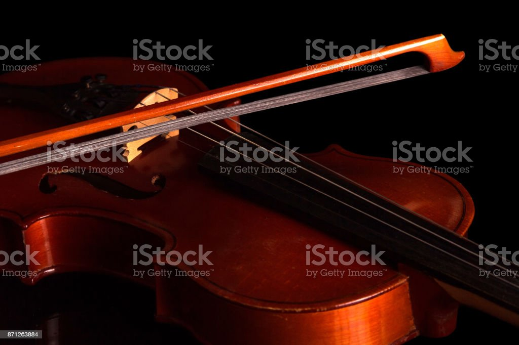 Violin and bow isolated on black stock photo