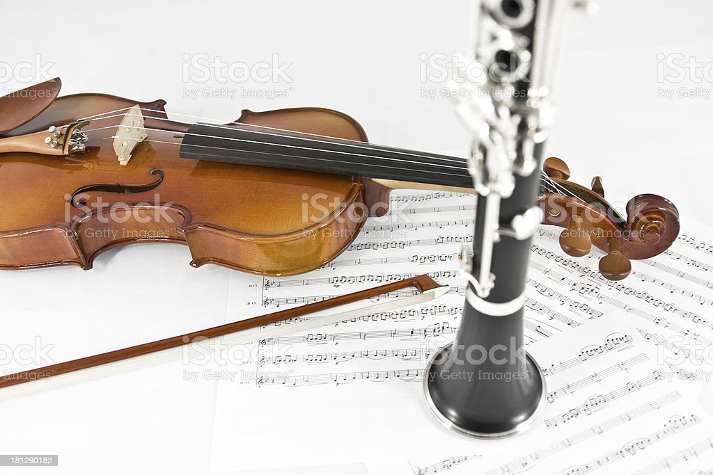 Violin and Clarinet on sheet music stock photo