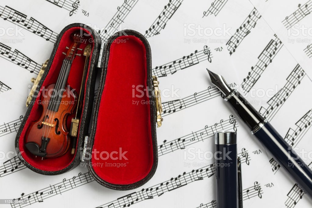 Violin and fiddle case on paper music notes with copy space