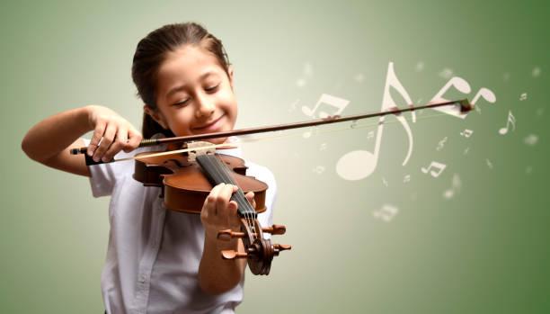 violin and girl stock photo