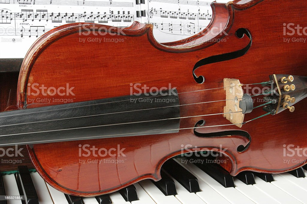 Violin and piano key stock photo