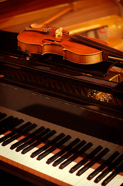 Violin and piano used for classical music stock photo