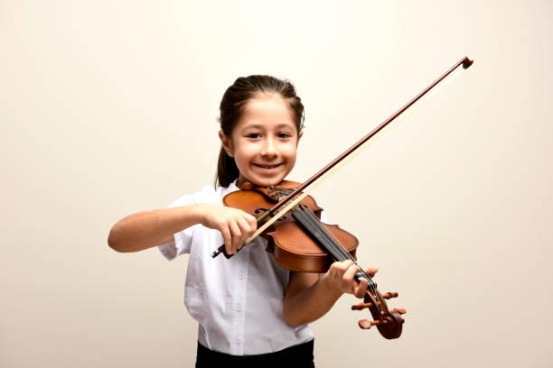 violin and smiling girl stock photo