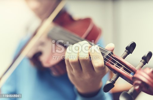 Violin in the artist's hand, blurred photo musical art