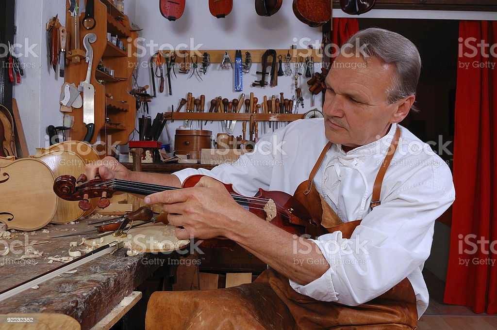 Violin builder and his workshop stock photo