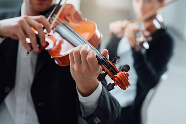violin duet performance - philharmonie stock-fotos und bilder