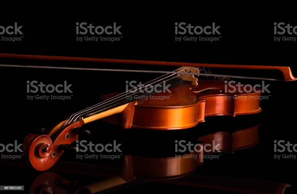 Violin end bow close-up isolated on black stock photo
