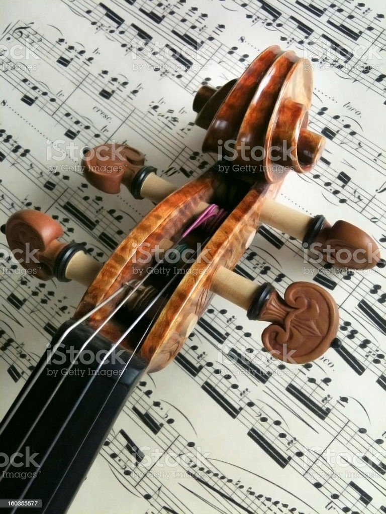Violin Head on Music - MobileStock royalty-free stock photo