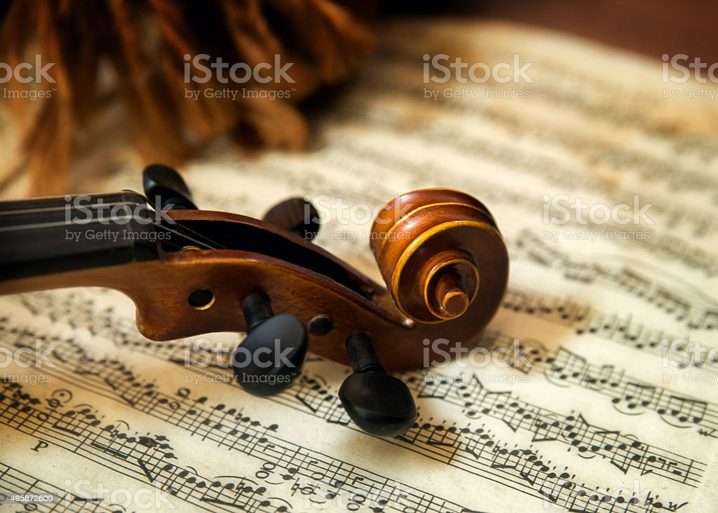 Violin head on sheet music stock photo