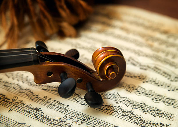 violin head on sheet music - classical stock photos and pictures