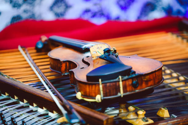 Violin in detail on cymbal. Dulcimer and violin with shallow depth of field and selective focus on the heart of the violin. Best picture of violin and cymbal. stock photo