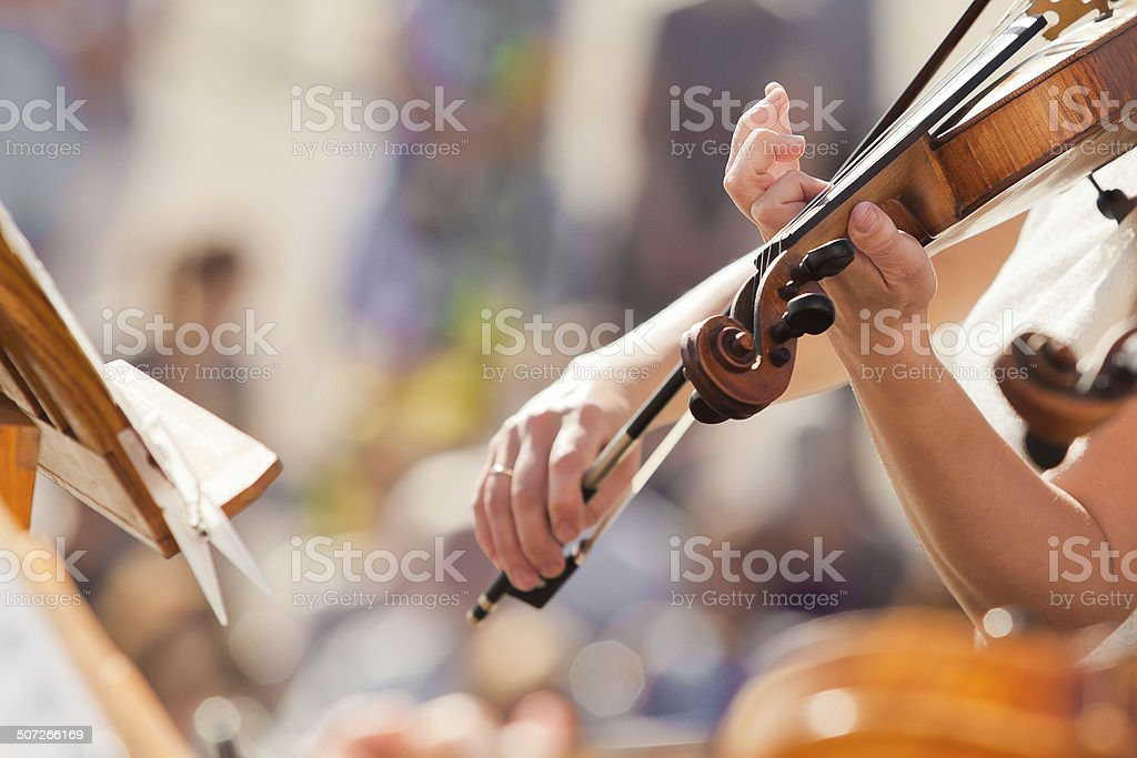 Violin in the hands of a musician stock photo