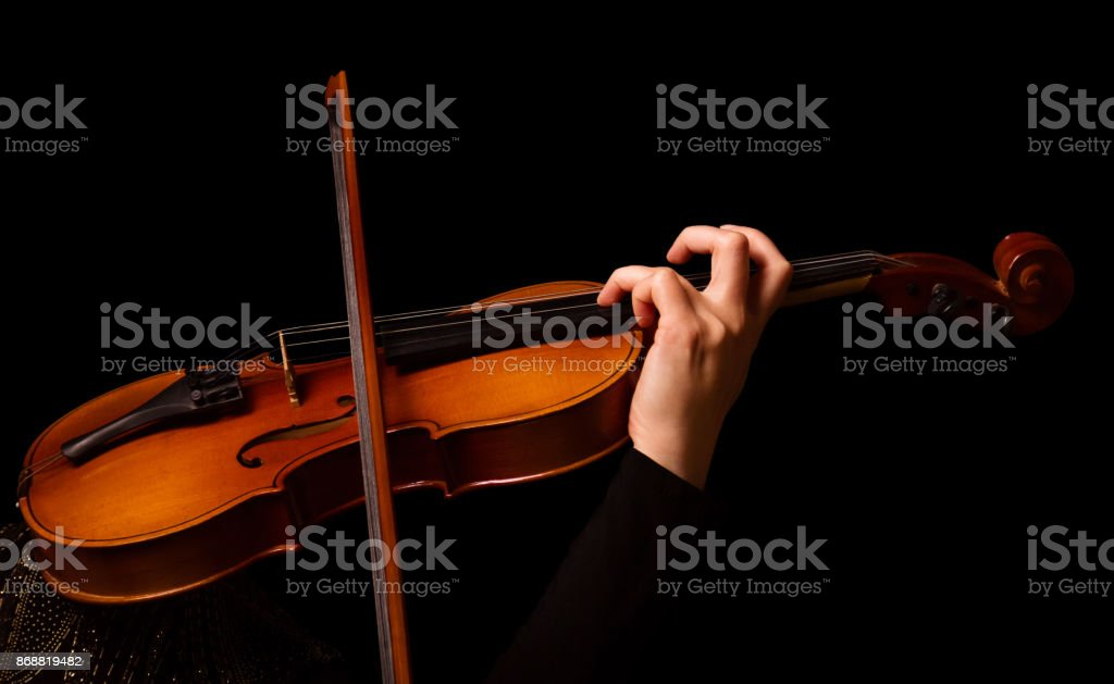 Violin in the hands of musician, isolated on black stock photo