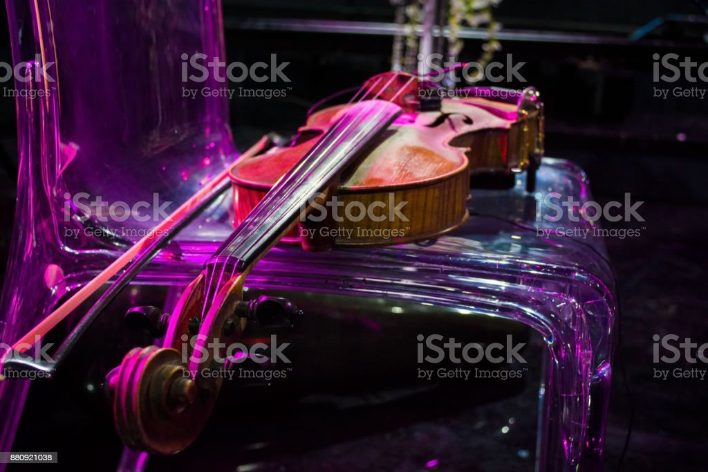 violin in vintage style on chair colorful background stock photo