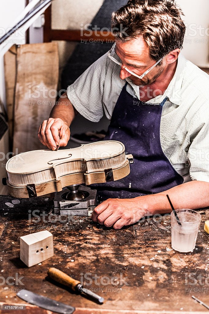 Violin Maker at Work in Cremona, Italy stock photo