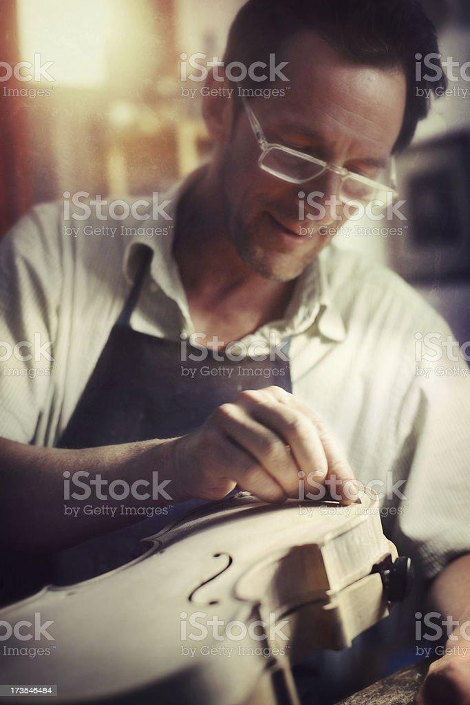 Violin Maker at Work royalty-free stock photo