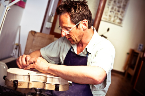 Violin Maker Working In Cremona Italy Stock Photo - Download Image Now