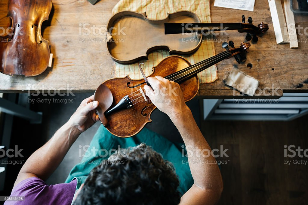 Violin Maker Working On Workbench stock photo