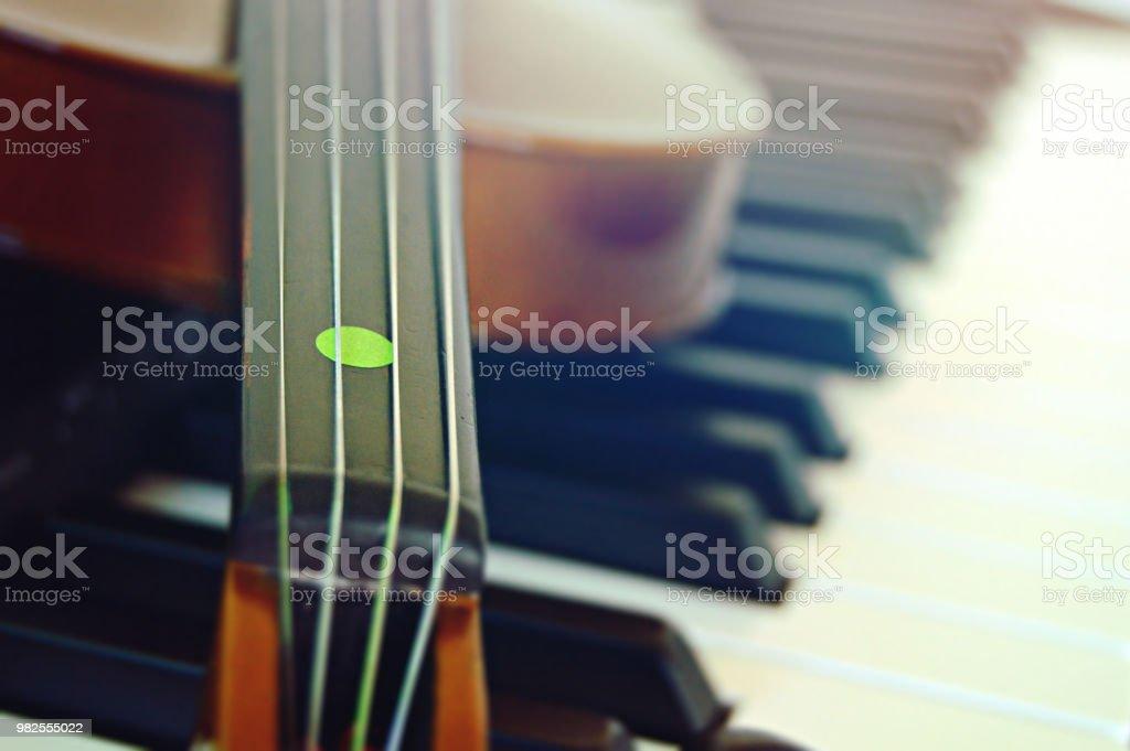 A violin on a piano keys stock photo
