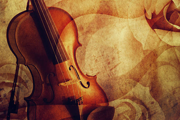 Violin on a romantic grunge background. stock photo