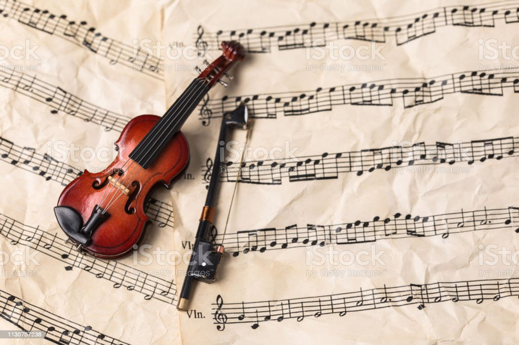 Violin on old paper music notes with copy space
