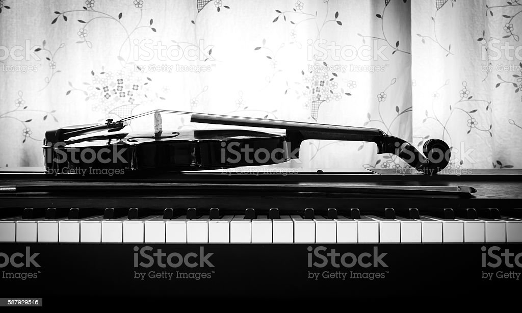 Violin on piano. Black and white theme. stock photo
