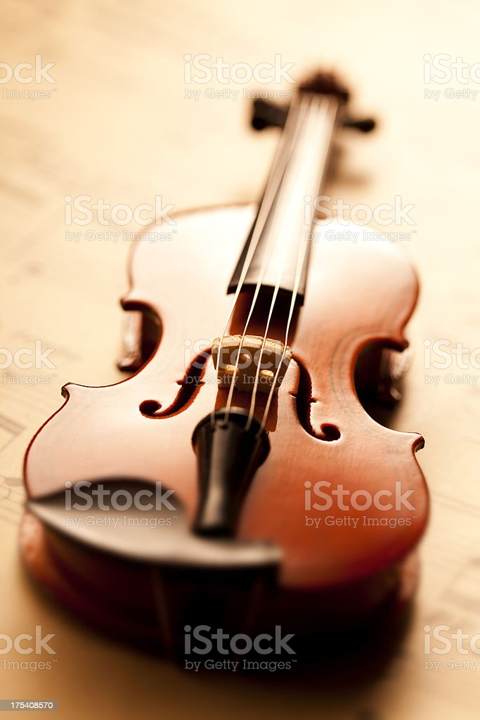 Violin on sheet music royalty-free stock photo