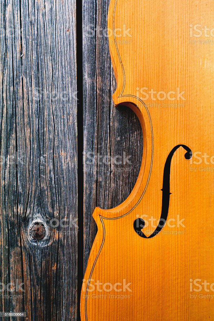 Violin on the wooden background stock photo