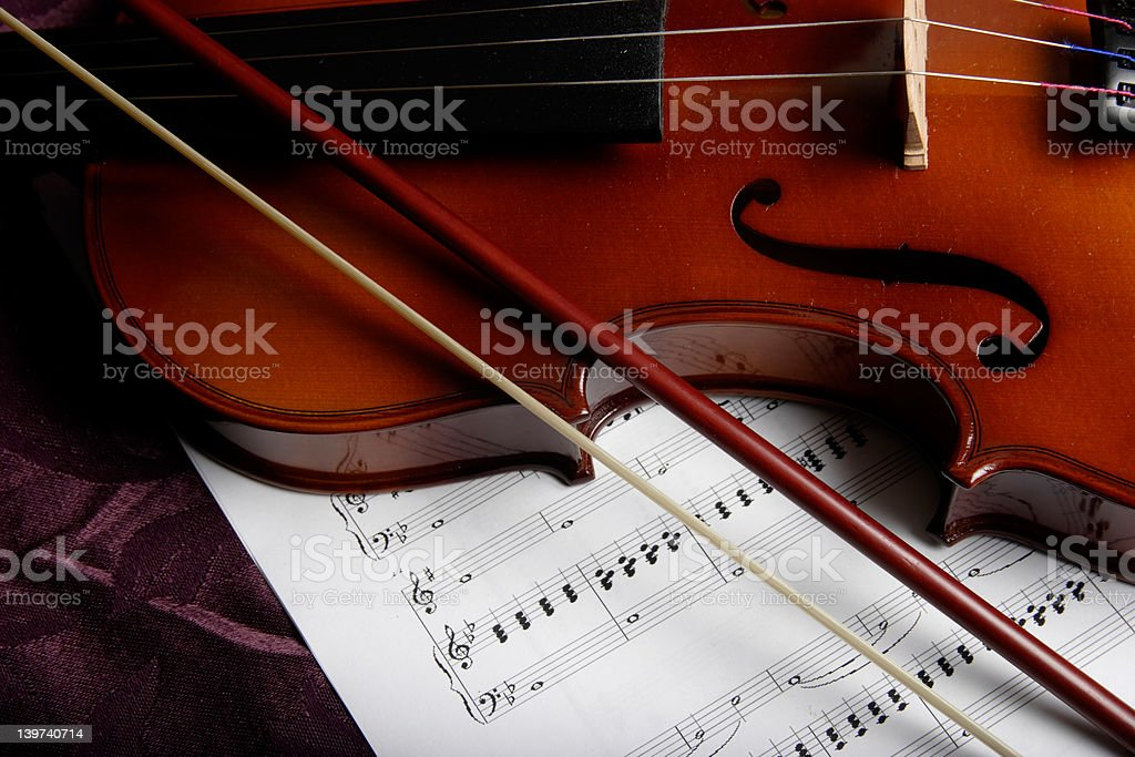 violin on top of sheet music royalty-free stock photo