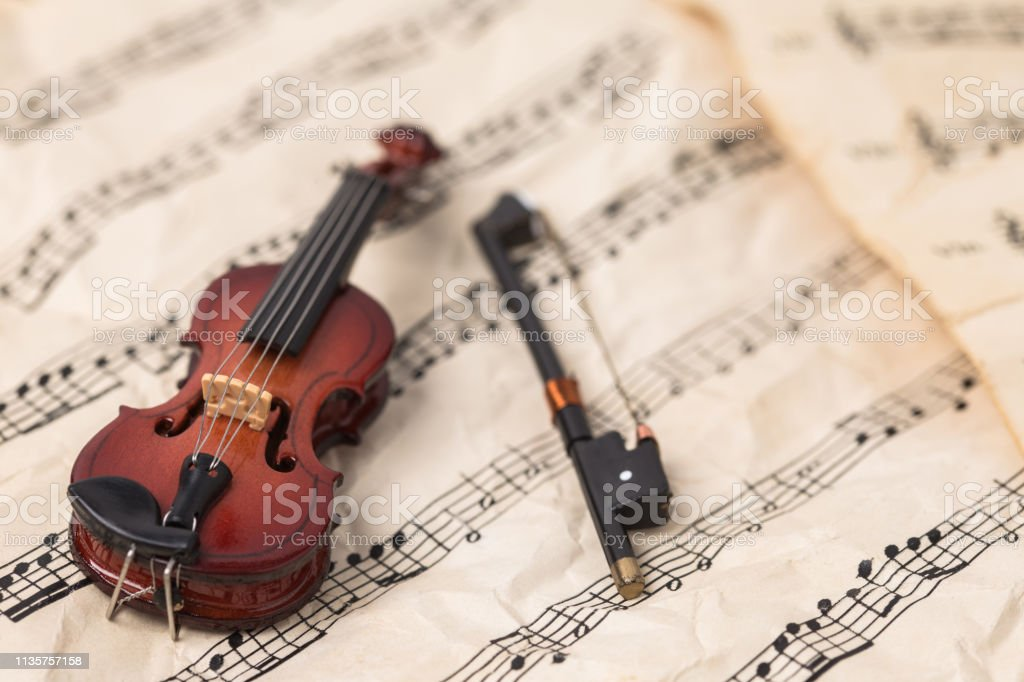 Violin on vintage paper music notes with copy space