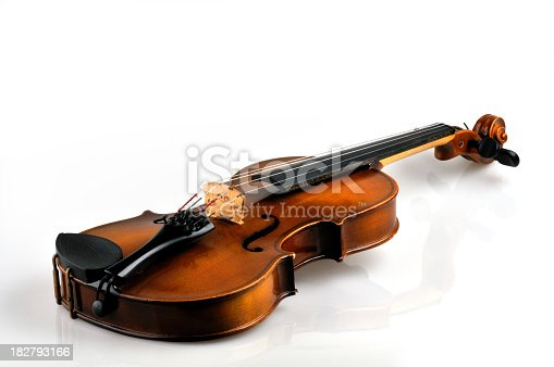 Old violin isolated on white with a vague reflection