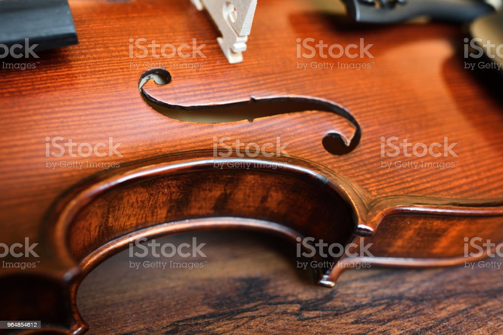 Violin on wooden background royalty-free stock photo