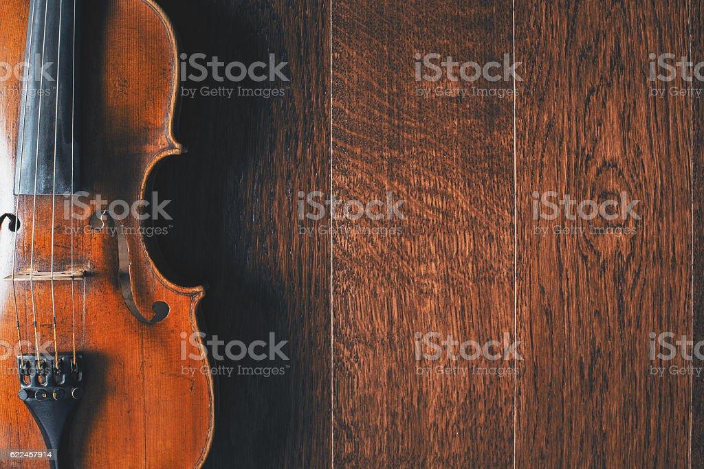 Violin on wooden floor stock photo