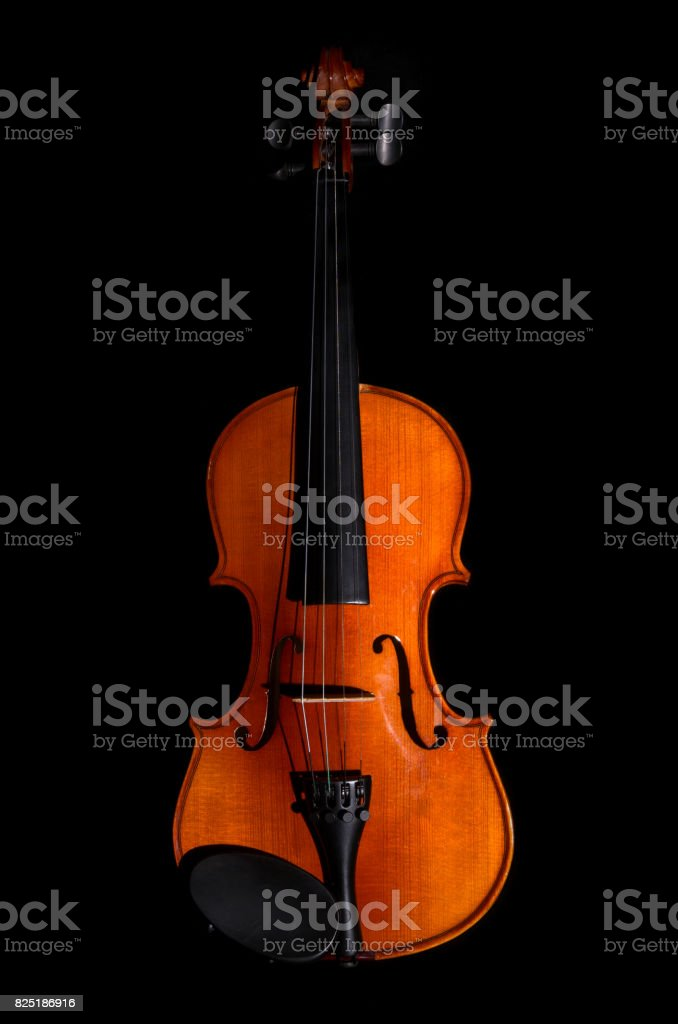 Violin orchestra musical instruments on black background stock photo