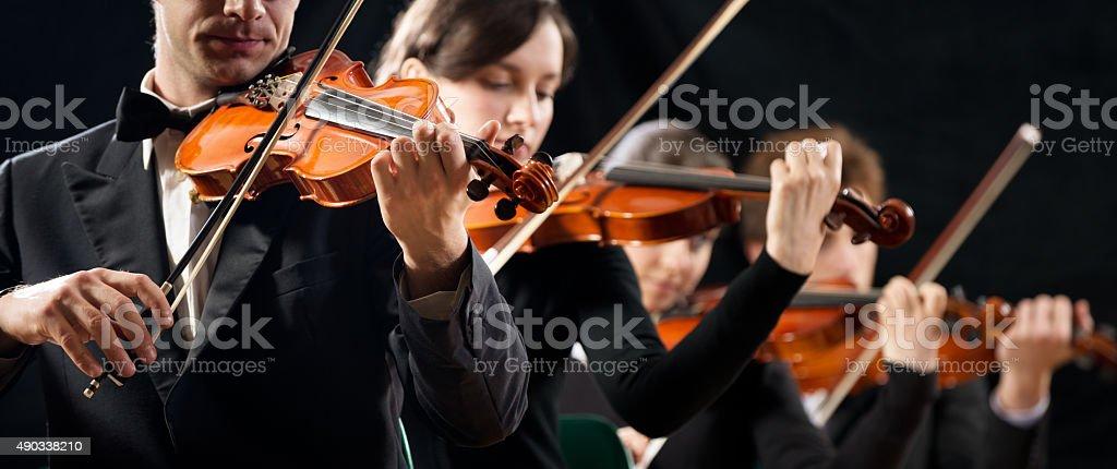 Violin orchestra performing stock photo