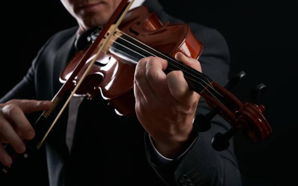 小提琴手的球員。音樂家、 演奏家、 小提琴小提琴音符背景。圖像檔