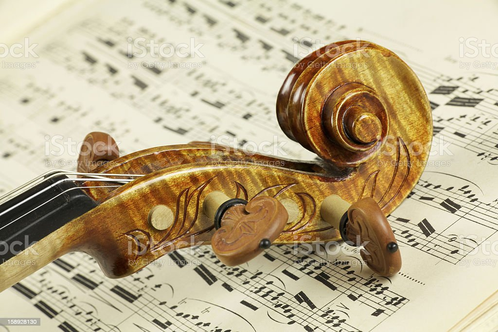 Violin Scroll on Music Background royalty-free stock photo