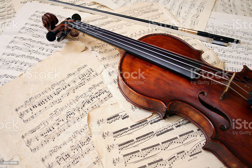 Violin with bow on sheet music royalty-free stock photo