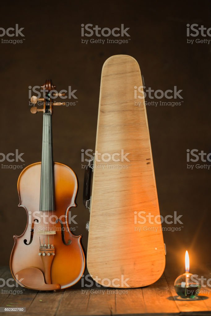 violin with lantern on old steel background,still life stock photo